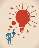 Smiling businesswoman thinking a big great idea light bulb
