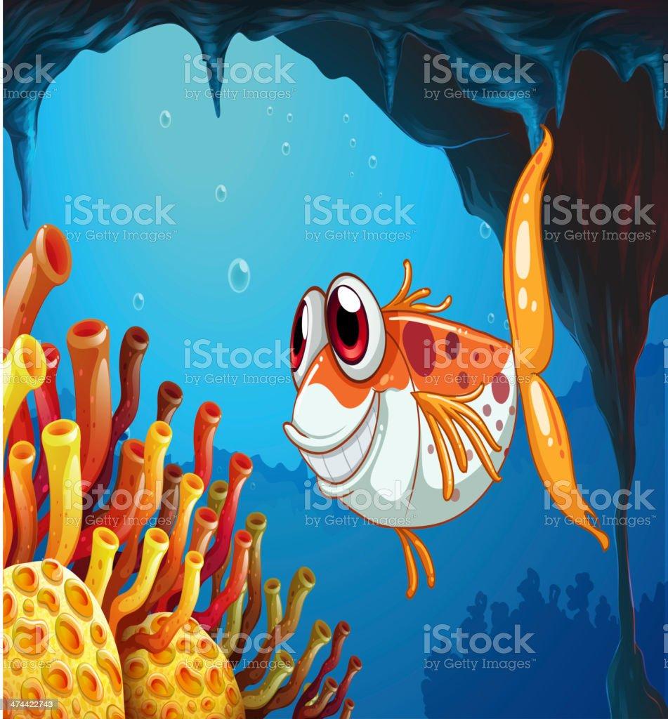 smiling fish under the sea inside cave vector art illustration