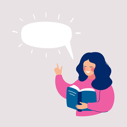 Smiling girl reading book with Speech bubble above