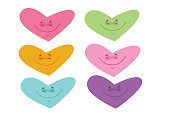 Set of illustrations of hearts in various colors, all with a smile, symbolizing tranquility, love and unity.