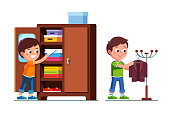 Smiling preschool boys kids making household chores. Organising clothes in closet and hanging suit jacket on floor hanger stand. Children cartoon characters flat vector clipart illustration.