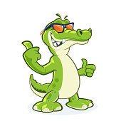 Cool crocodile mascot with sunglasses and thumb up