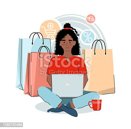 istock Smiling young african american woman holding a laptop with shopping bags on background. Online shopping concept. Vector flat illustration. 1283732469