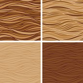 Seamless background textures in 4 coffee colored variations.