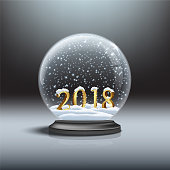 Snow globe with shiny snow and 2018 golden sign. Vector Christmas and New Year design element.