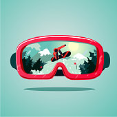 Snowboard protective mask with snowboarder on reflection.