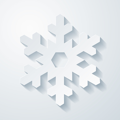 Snowflake. Icon with paper cut effect on blank background