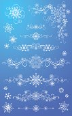 White ornate elements for your design with snowflakes isolated on a blue background
