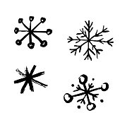Vector illustration of a collection of snowflakes in a hand drawn style.