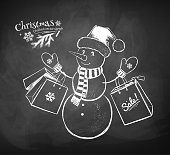 Vector chalk drawn illustration of cute Snowman character wearing Santa hat with shopping bags and decorated Christmas tree on chalkboard background.