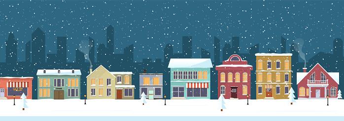 Snowy night in cozy christmas town city panorama.