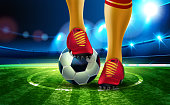 Soccer ball on Football Arena with a part of the foot of a football player. Night background football field stadium and fans 2019 soccer championship.