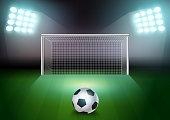 Soccer ball on the green field in soccer stadium