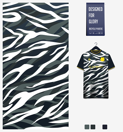 Soccer jersey pattern design.  Abstract pattern on black background for soccer kit, football kit or sports uniform. T-shirt mockup template. Fabric pattern. Sport background.