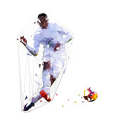 Soccer player kicking ball, low polygonal vector illustration. Football player