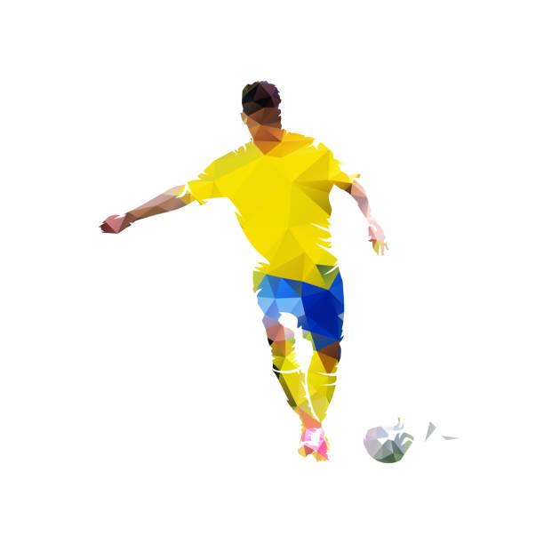 stockillustraties, clipart, cartoons en iconen met voetbalspeler schoppen bal, laag veelhoekige vector illustratie. geïsoleerde geometrische voetballer in gele jersey, vooraanzicht - soccer player
