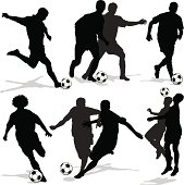Vector illustration of male soccer player silhouettes.