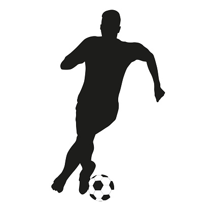 Soccer player vector silhouette with ball