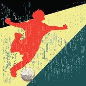 Soccer youth strikes ball through heavy rain.