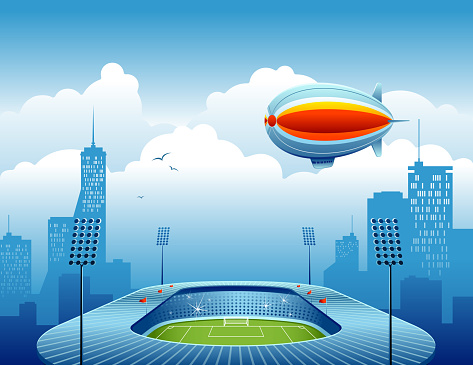 Soccer Stadium with City Skyline and Air Blimp
