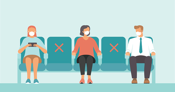 Social distance in public place. Seating regulations in airport area. People wearing mask to prevent infection from coronavirus COVID-19.