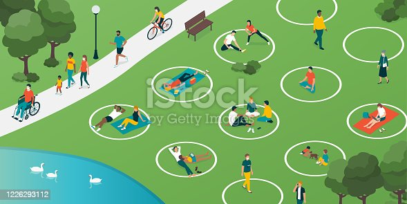 istock Social distancing circles in the city park 1226293112