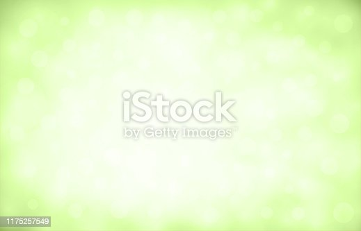 Soft pastel green and white colour shining glittery blurry horizontal background stock photo. Looks like twinkling lights light shiny sky background. Vignette, vignetting, copy space. No people. No text. Apt for party, Xmas, Christmas, New Year's eve, New Year, birthday party celebration backdrop, wallpaper,  romantic gift wrapping paper, greeting cards. There are subtle light coloured circles of different sizes and overlapping making it blingy and shimmery. Divine, spiritual background. Corners have more color.