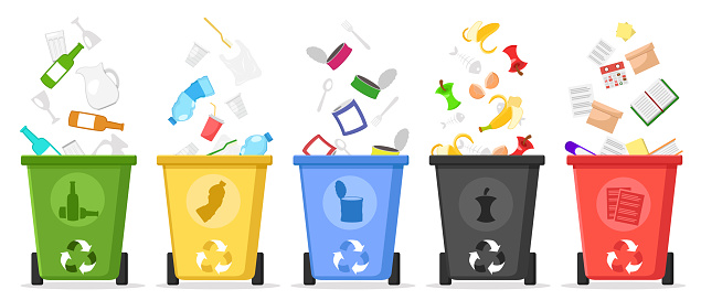 Sorted rubbish falls into trash cans on a white. Waste recycling
