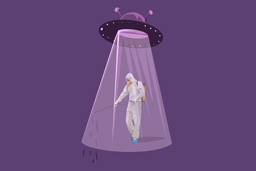 NLO UFO spaceship and a man in a protective suit