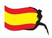 Athletic woman silhouette holding Spain´s flag.