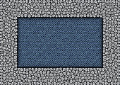 Silver sequin rectangle frame on blue jeans background.