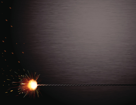 Ignited fuse in front of a brushed steel background. Files included – jpg, ai (version 8 and CS3), svg, and eps (version 8)