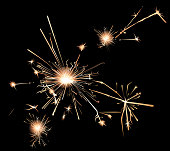 Sparklers in a bark background