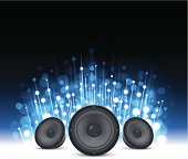 Music speakers on a bright blue sparkling background.  EPS 10 file using transparencies