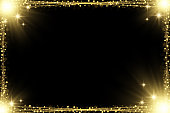 Shiny golden particles glowing yellow lights decorative rectangular frame