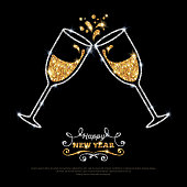 Sparkling gold silver champagne glasses.