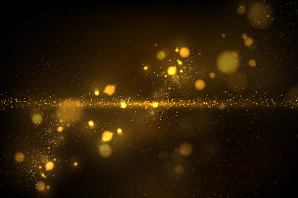 sparkling golden particles on black - spark stock illustrations