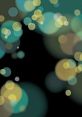 Geometric vector background with blurred, circular light lens effect in green and yellow on black background.