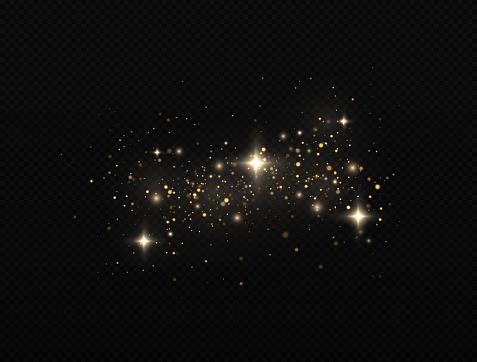 Sparkling magic dust particles. Bokeh effect. Yellow dust.