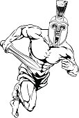 An illustration of a warrior or gladiator character or sports mascot  in a trojan or Spartan style helmet holding a sword.