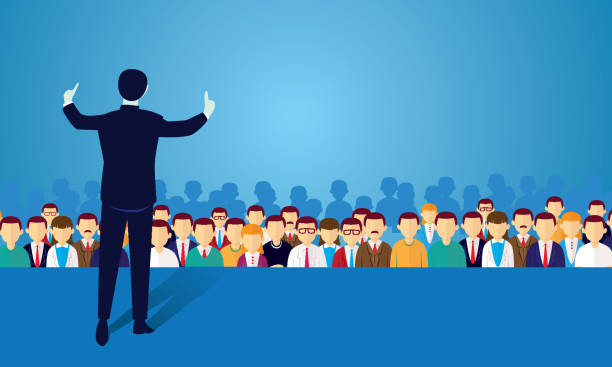 Speaker at Seminar Vector illustration of speaker businessman giving lecture at seminar, politician campaign on stage in the front of crowd audience stock illustrations