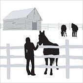 A vector silhouette illustration of a young man patting the nose of a hourse behind a fence.