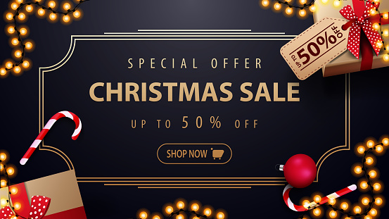Special offer, Christmas sale, up to 50% off, dark blue discount banner with garland, gold vintage frame and presents, top view