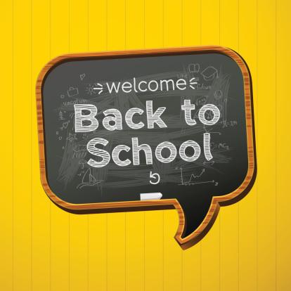 A speech bubble shaped blackboard saying 'back to school'