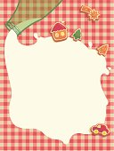 Christmas background with bottle of milk and cookies on grid pattern tablecloth.