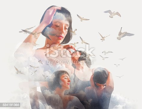 istock Spiritual Woman, Clouds and Birds 534191365