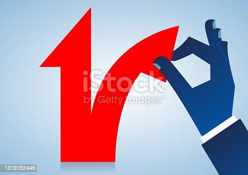 istock Split, hand tearing up the red arrow growing upwards 1319152445