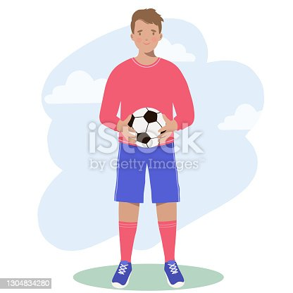 istock Sport. Football Player holds a soccer ball in his hands. 1304834280