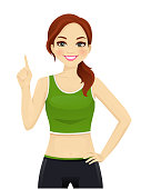 Sport fitness woman pointing up isolated vector illustration
