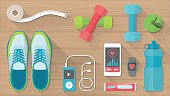 Sports and physical activity equipment, healthy food and wellness banner, objects set on a wooden floor, top view